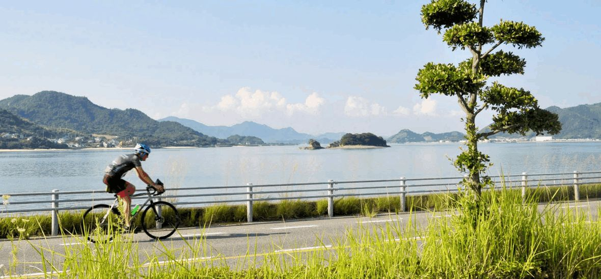 Cyclist riding along coastal road