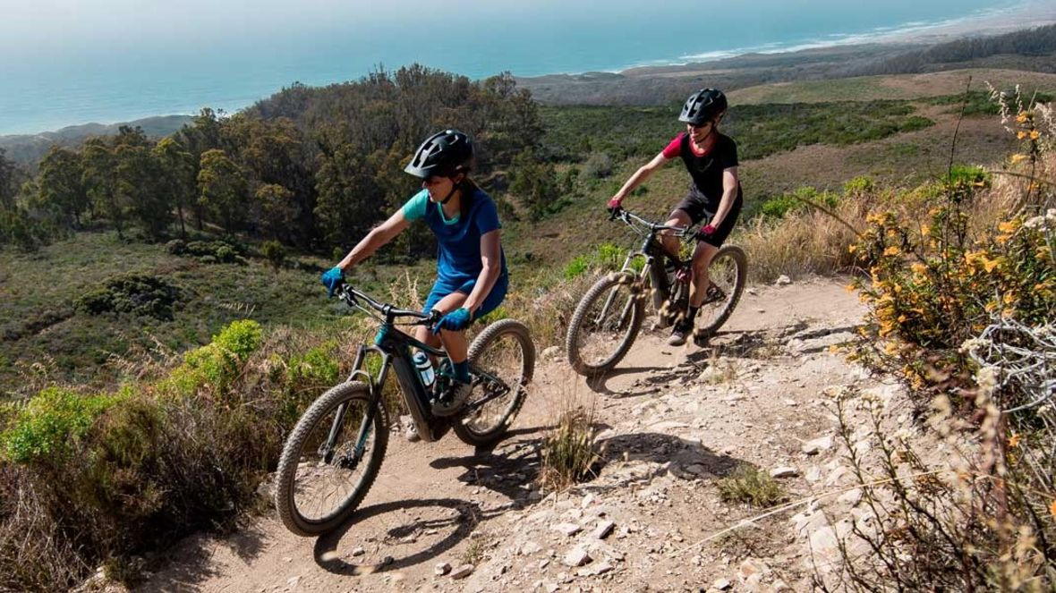 Ladies getting a ride and workout on e-MTBs