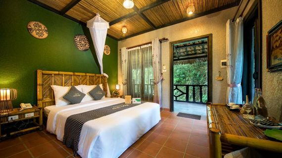 Immerse yourself in the peaceful surroundings of rice paddies and soaring mountains
