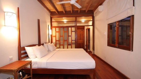 Relish your final days on the tour in this boutique colonial style hotel by the Mekong River