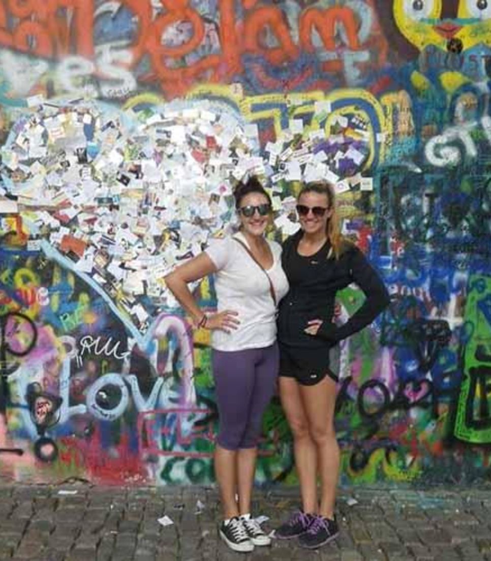 Walk the length of the spectacularly-graffitied Lennon Wall
