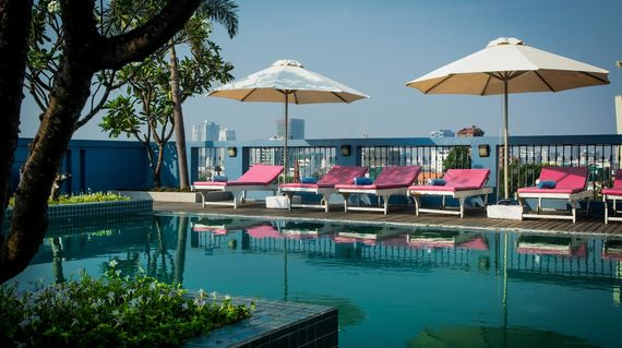 A boutique hotel with a rooftop pool and minutes away from the river front area and Royal Palace.