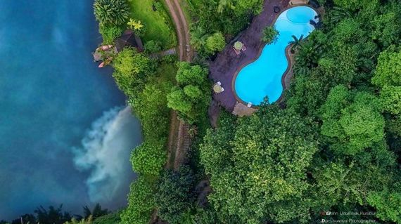 Serene resort surrounded by a tropical rainforest.