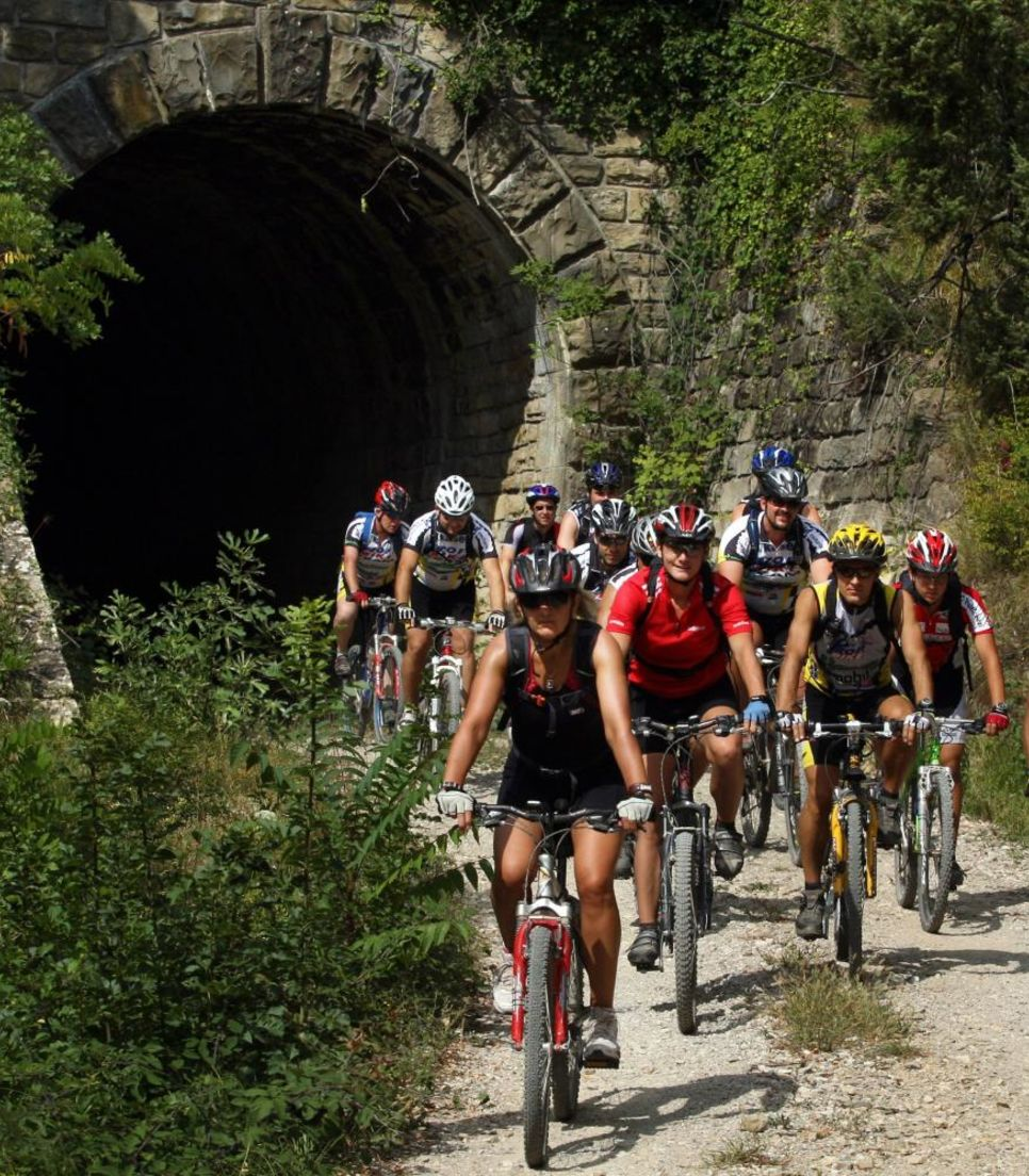 Ride through tunnels, old bridges, unused railways and medieval towns.