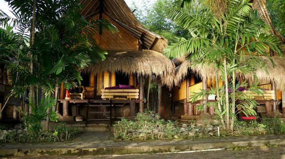 Low-key Balinese accommodations featuring bamboo bungalows