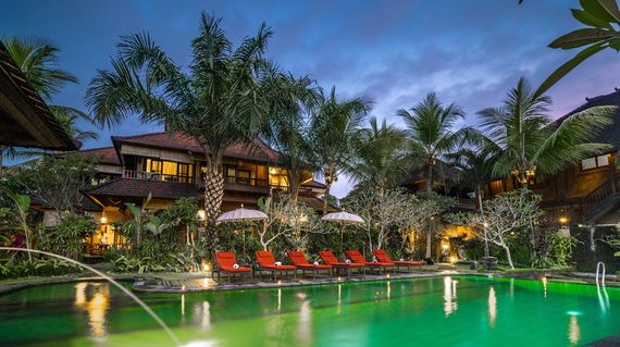 Traditional Balinese style hotel surrounded by lush paddy fields
