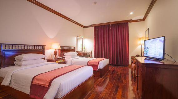 French colonial hotel with warmly decorated rooms