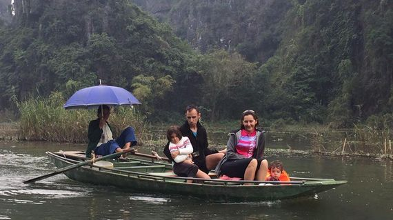 Put your feet up whilst the sampan rower uses his feet to row you through a cave and onto luscious green landscapes
