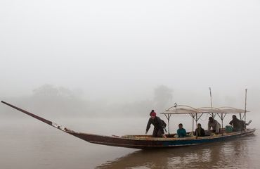 Thai boat on foggy river
