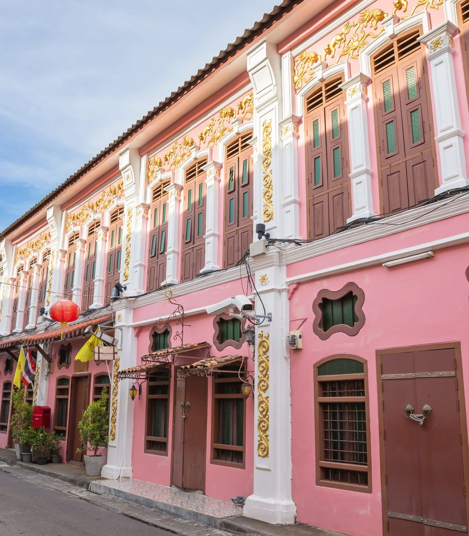 Explore the beautiful buildings of Sino-Portuguese origin in the town that are both colorful in their past lives and in appearance