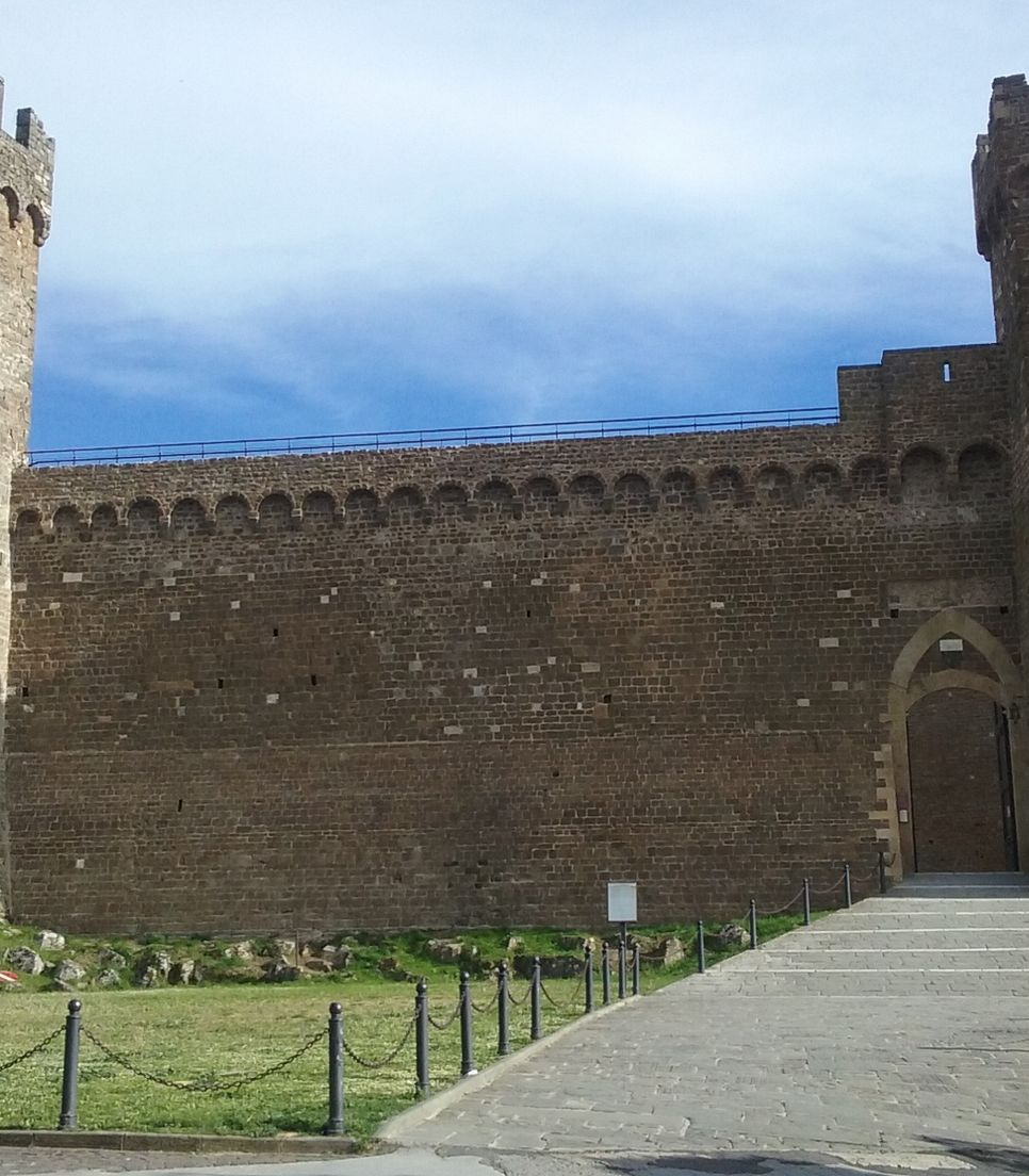 Cycle into Montalcino, a town well-known for its Brunello wine