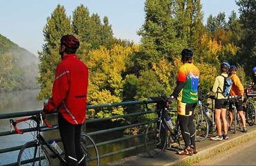 Group of cyclists looking over the water