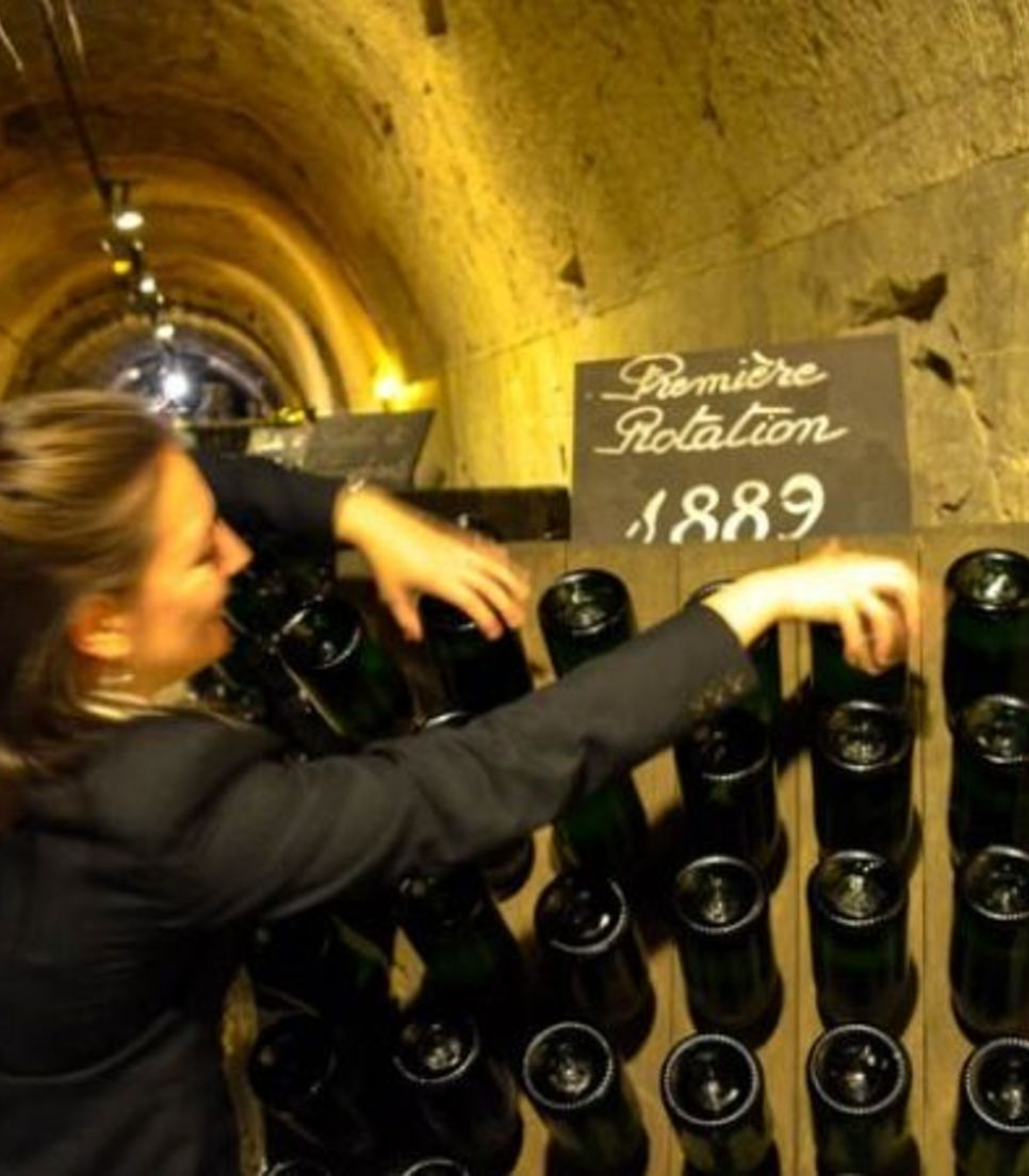 Visit champagne houses and tour the underground cellars