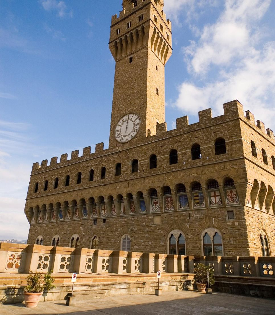 Explore the iconic honey-colored buildings and rolling countryside of Tuscany