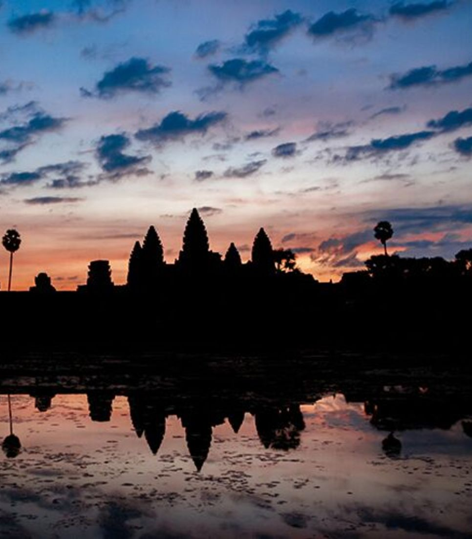 Go on a sunrise cycle to discover the ancient temples at Angkor