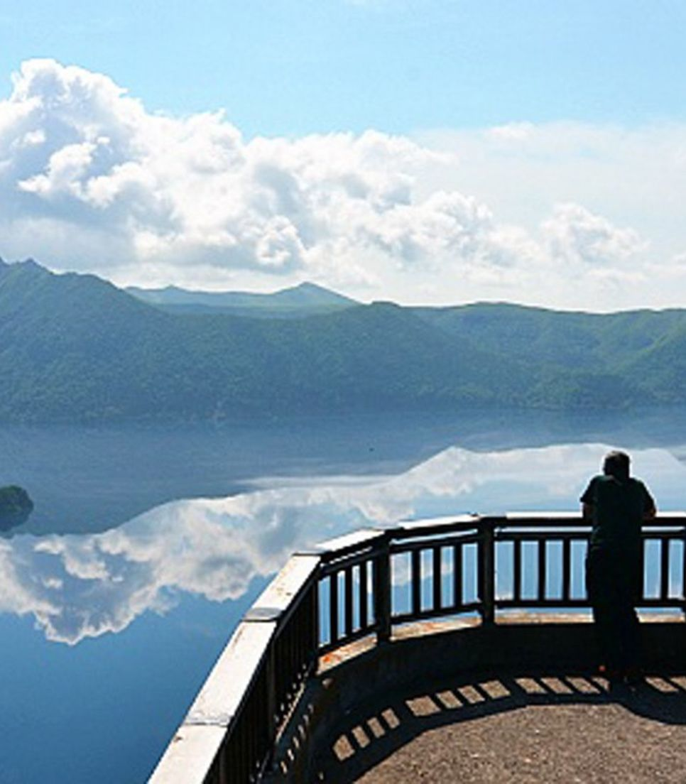Cycle along lakeside paths with gorgeous mountain views