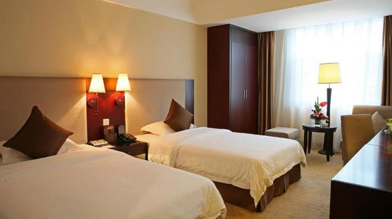 A riverside hotel with modern rooms and amenities