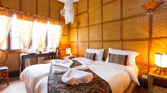 Unwind in lush gardens and rustic guestrooms at the heart of Bolaven Plateau.